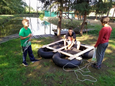 Creativity - making a raft from tires, wood and rope!